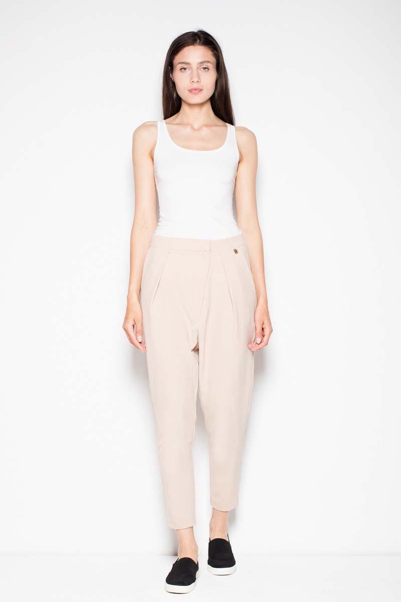 Image of Beżowe damskie spodnie z zaszewkami